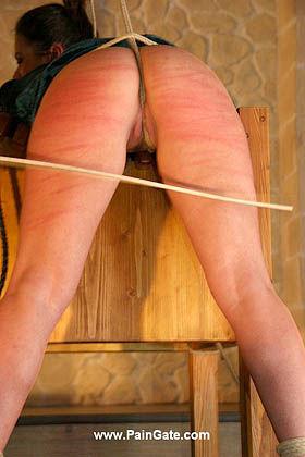 WITH EVERY BULLWHIP LASH THE CROTCH ROPE CUTS DEEPER INTO HER JUICY PUSSY!