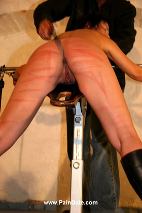 EVEN A STRIPTEASE CANNOT PREVENT HER FROM THE WHIPPING POST